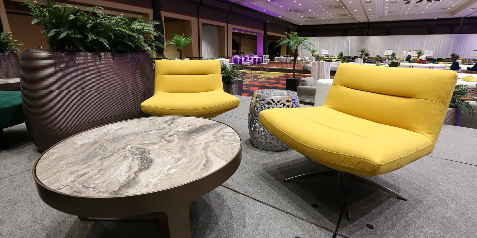 yellow chairs with gray marble table