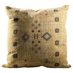 yellow pillow with southwestern graphic