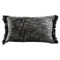 black and white lumbar pillow with frayed edges