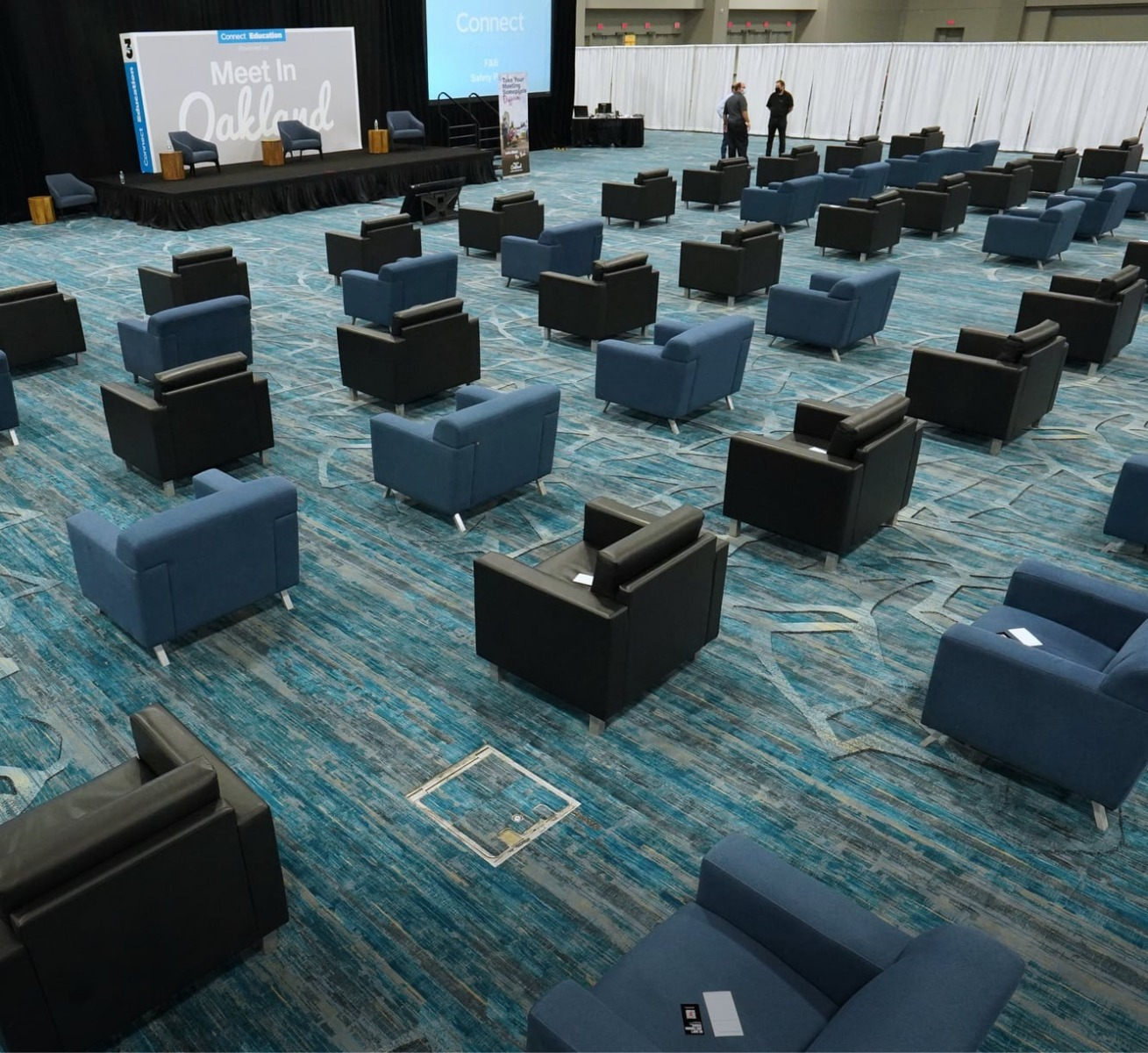 black and blue chairs in socially distanced general sesion