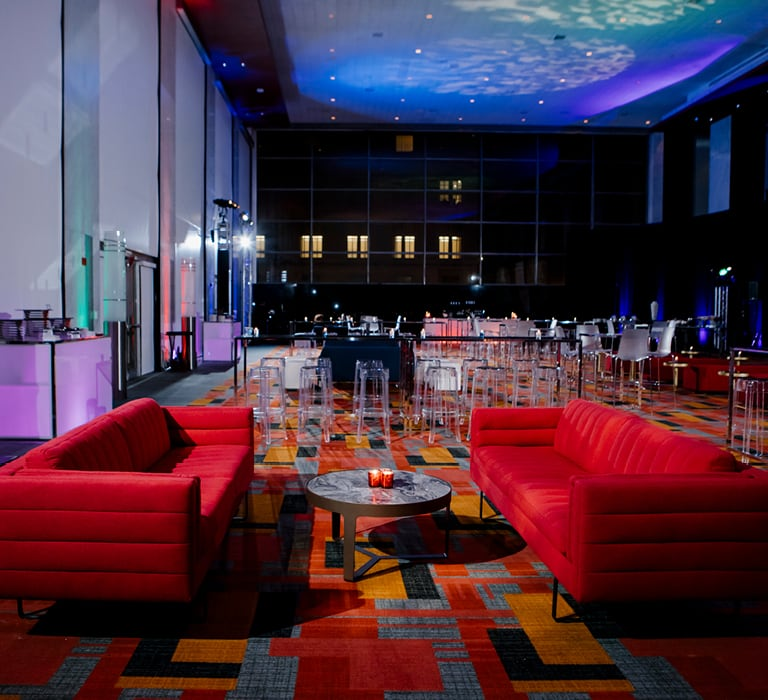 red padded sofas in a hotel ballroom