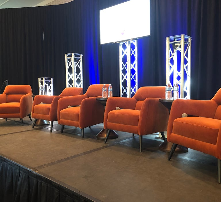 spice orange club chairs on stage