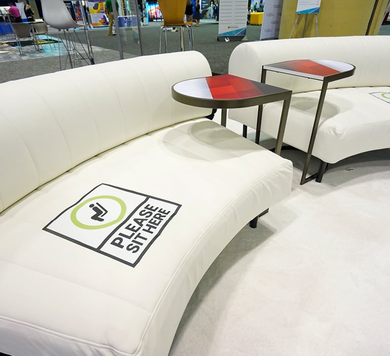 white lounge seating in booth
