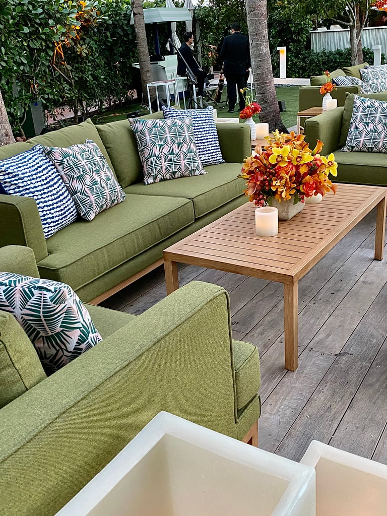 green outdoor soft seating at poolside event
