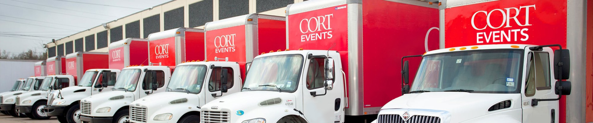 line of red CORT trucks